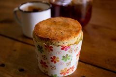 Muffin with cup and tea in background royalty free stock photo