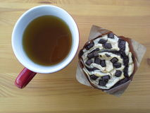 Muffin And Tea Break Royalty Free Stock Photos