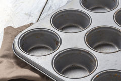 Muffin tray on wooden table Royalty Free Stock Images