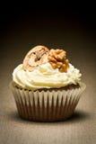 Muffin and vanilla cream with walnut stock photo