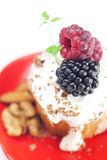 Muffin with whipped cream and berries Royalty Free Stock Photos