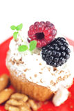 Muffin with whipped cream and berries Stock Images