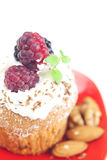 Muffin with whipped cream and berries Royalty Free Stock Photography