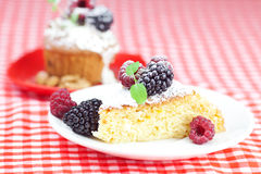 Muffin with whipped cream and cake with icing Stock Photography