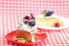 Muffin with whipped cream and cake with icing Royalty Free Stock Photos
