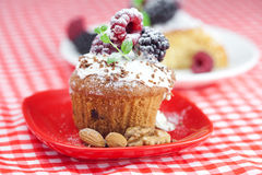 Muffin with whipped cream and cake with icing Royalty Free Stock Photo