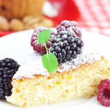 Muffin with whipped cream and cake with icing Stock Image