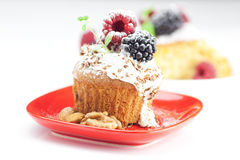 Muffin with whipped cream and cake with icing Stock Photo