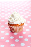 Muffin with white cream on colored background, close up Royalty Free Stock Images