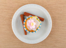 Muffin on a white plate. Muffin and cinnamon stick, on a white plate Stock Photos