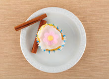 Muffin on a white plate. Muffin and cinnamon stick, on a white plate Royalty Free Stock Photography