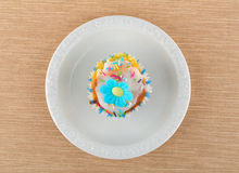 Muffin on a white plate. Colorful, homemade muffin on a white plate Royalty Free Stock Photography