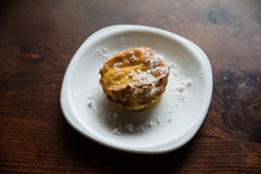 The muffin. On a white plate with some sugar powder Royalty Free Stock Photo