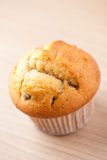 Muffin on wooden table stock photo