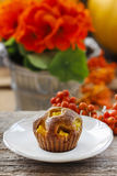 Muffin on wooden table Stock Photos