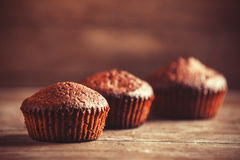 Muffin on wooden table. Stock Images