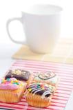 muffiner för kaffekopp arkivfoton