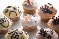 Muffiner med dekorerat bästa Arkivfoton