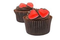Muffiner med röda gelésötsaker Arkivbilder
