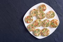 Muffins αυγών με το κρεμμύδι Στοκ Εικόνες