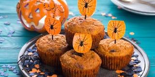Muffins κολοκύθας για το κόμμα παιδιών αποκριών Στοκ Φωτογραφίες