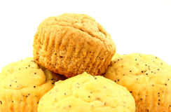 Muffins. Lemon poppy seed and banana nut muffins piled high on a white background and photographed close up Stock Photo