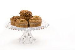 Muffins. A crystal serving plate filled with poppy seed and banana-walnut muffins on white background stock photos