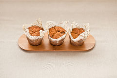 Muffins. Three fresh homemade cereal muffins Royalty Free Stock Photos