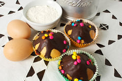 Muffins. On the table with eggs, sugar and flour Royalty Free Stock Photography