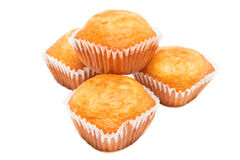 Muffins. Pile of four muffins close up isolated on white background Royalty Free Stock Photography
