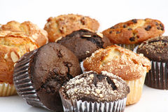 Muffins. Chocolate and blueberry flavored muffins stock photography