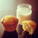 Muffins with the addition of yogurt. Jar of homemade yogurt. Royalty Free Stock Images