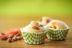 Muffins with almonds and dried apricots Royalty Free Stock Images