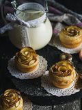 Muffins with apples and milk jug on the table Stock Photos