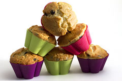 Muffins. Baked muffins in different colored cups stock photo