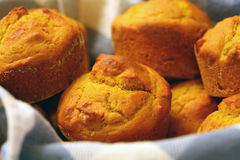 Muffins in a Basket. Close up of pumpkin muffins in a basket royalty free stock photography