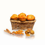 Muffins in a basket with nuts, almonds and cinnamon Royalty Free Stock Photo