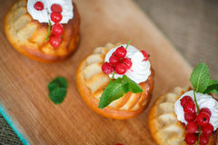 Muffins with berries and cream Royalty Free Stock Photo