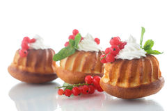 Muffins with berries and cream Royalty Free Stock Photos