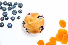 Muffins with blueberries and apricots overhead sho stock photos