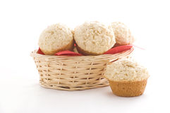 Muffins in busket. On the white background stock image
