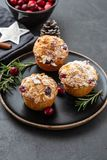 Muffins, cakes with cranberry, rosemary and almond nuts. Christmas decoration. Copy space. royalty free stock photo