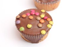 Muffins with candies Stock Photos
