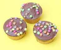 Muffins with candies Stock Images