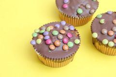 Muffins with candies Royalty Free Stock Photography