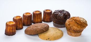 Muffins, Cannelles and Cookies. Assortment of dessert pastries - cannelles, muffins and cookies stock photos