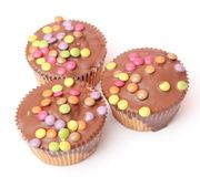 Muffins chocolate and colourful candies Stock Photography