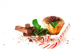 Muffins with chocolate decorated with mint Royalty Free Stock Image