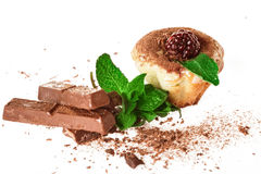 Muffins with chocolate decorated with mint Royalty Free Stock Images