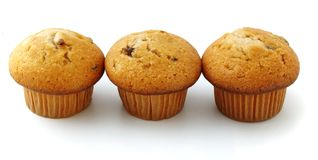 Muffins with chocolate filling. Isolated on white background Stock Image
